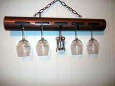 Wine glass rack...made of PVC, painted in antique metallic finish.