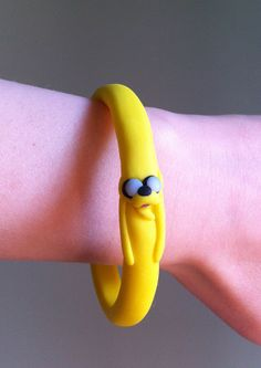 Adventure Time Jake bracelet handmade in clay! It reminds me of that episode when he stretched himself out way too much to save the Hot Dog Princess' Hot Dog Guards...