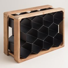 A black metal honeycomb shape with a rustic wood frame, this wine rack looks great displayed alone or with multiples lined up next to each other. >> #WorldMarket Urban Industrial