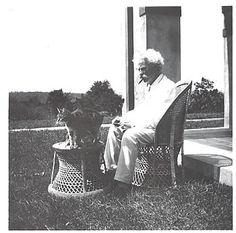 """in the chair, 'Mark Twain' wrote: """"When a man loves cats, I am his friend and comrade, without further introduction."""""""