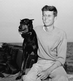 John F. Kennedy relaxes at Hyannis Port, Massachusetts with his dog after winning the nomination for Congressman from Massachusetts. Get premium, high resolution news photos at Getty Images Weimaraner, Rottweiler, Jfk And Jackie Kennedy, Kennedy Jr, Jfk Jr, Young Jfk, Le Clan, Doberman Love, Famous Dogs