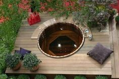 Wooden barrel hot tub. How rustic.