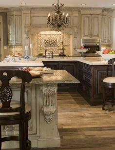 Romantic kitchen with chandelier. I also love the light upper cabinets and dark lower.