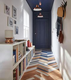 Colourful parquet and navy ceiling in this fab hallway!