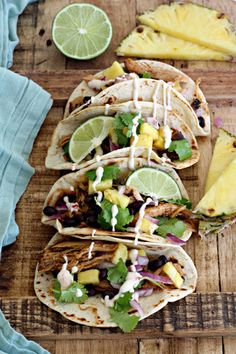 Jerk Pineapple Pulled Pork Tacos with pineapple cilantro slaw and sweet spicy drizzle.