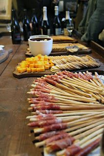 Cheese and cracker spread. Love these breadsticks pre-wrapped with prosciutto. It acts as a skewer.