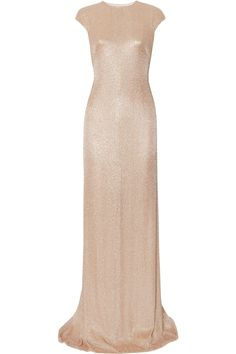 Sheer nude backless dress w/ a pretty demure neckline and embellished w/ thousands of blush sequins and beads, understated glam. #bananas  Kaufmanfranco