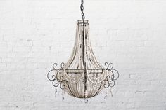 (White - Large)  With each clay bead hand rolled, kiln fired, then dip dyed before being strung onto a wrought iron frame, this statement chandelier is one of the most popular in our range.