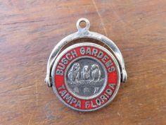 Vintage silver BUSCH GARDENS TAMPA FLORIDA SPINNER FLIP SOUVENIR MOVEABLE charm