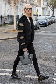 Black-out: Poppy Delevinge was a combination of both gothic and glam as she stepped out fo...