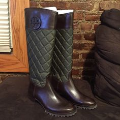 Tory Burch Rider Boots Brown leather foot and top of boot with hunter green quilted material. Slip on and off. These boots have never been worn but please see pictures for slight marks from being in box and from being shipped. Marks are barely noticeable and could be buff with leather cleaner or by shoe maker. Comes with box. 1.5-2 inch heel. Tory Burch Shoes Heeled Boots
