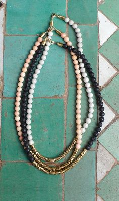 Handmade of pale grey riverstone, peach marble and smooth black lava stone. #necklace