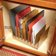 B.I.G. Tip of the Day! Use an old metal desk organizer for great vertical storage of baking sheets, cutting boards and trays!