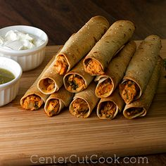 Skinny Creamy Taquitos--These Skinny Creamy Taquitos are baked, not fried! And instead of cream cheese, the creaminess comes from greek yogurt. Stuffed with chicken, cheese, cilantro, and onion