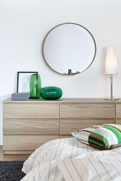 Integrated drawer handles lend to the clean modern profile of the MALM dresser, while white stained oak veneer, that will age gracefully over time, softens the look to add to a quiet, zen-like feeling in the bedroom.