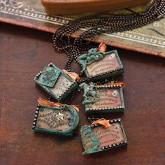 Pay an homage to the Ouiji board with these soldered charm necklaces by Susan A. Ray inside Belle Armoire Jewelry.