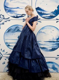Love the tiled mural & multi-dimensional color & texture of the dress. Her demure, child-like stance ain't bad either.