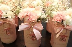 Child bathe centerpieces. I painted every jar pink, frivolously sanded it to provide it ...