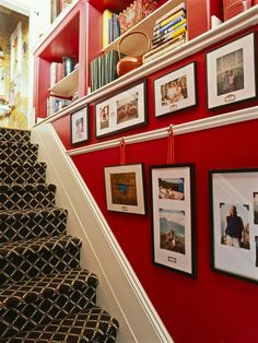Extend Display with Picture Rails - Capitalize on the length of a stairwell by attaching bands of decorative molding that function as picture rails. For a pulled-together look, place items in similar frames and mats and embellish with hanging ribbons and coordinating labels.