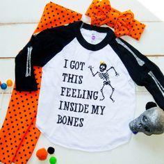 Halloween sparkle shirt. Halloween raglan. Shop now on www.sparklebowtique.com even the sleeves have sparkle bones too cute!!!