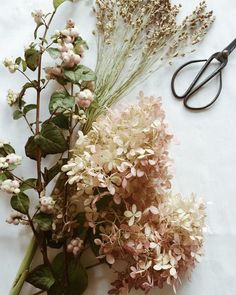 dreamy bohemian flower arrangement - love the mixed materials and simple colors