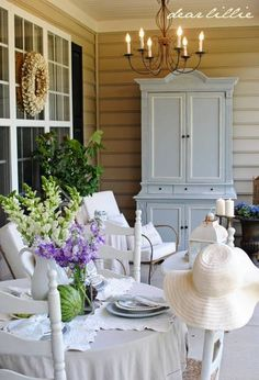 Love this storage idea! Put an old wardrobe on the porch for blankets, candles, outside games, etc.