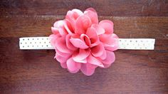 This adorable handcrafted baby headband features a 3.5 chiffon flower in salmon on a 5/8 ivory and gold polka dot elastic. Perfect for photo