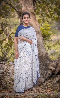 PRICE INR 5,999/- US$ 90.00 Click here https://www.eastandgrace.com/products/ink-stain-silk-chiffon-saree Featuring the Ink Stain Muslin-Cotton hand painted saree in white with blue tassels along the border. The blue ink stain pattern is painstakingly hand-painted all over the saree. Each saree is therefore unique. The matching blue blouse has peter pan collar, puff sleeves with elastic edging and adorable white, tiny ribbon bows at the back along the closure line. Reach…
