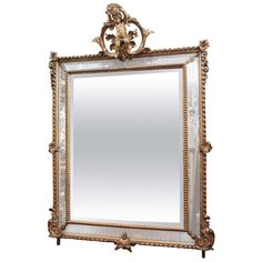 19th Century French Double Framed Giltwood Mirror with Cherub on Crown | From a unique collection of antique and modern wall mirrors at https://www.1stdibs.com/furniture/mirrors/wall-mirrors/