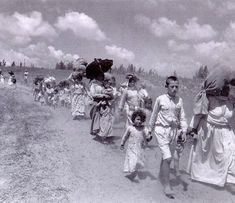 Photo of Palestinian woman and children fleeing. In 1948, 804,767 Palestinian men, women, and children were forced to flee their homes. This photograph shows a train of Palestinians who were soon to become lifelong refugees.