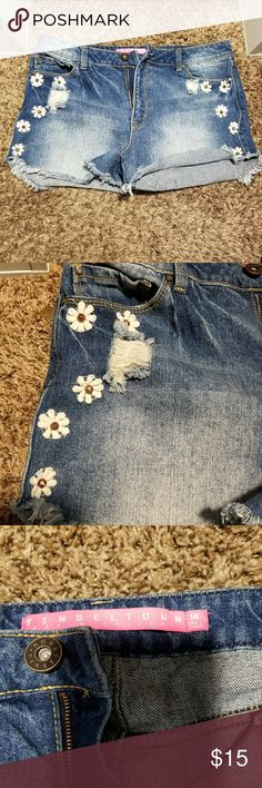 Flower distressed shorts Purchased from Charlotte Russe and never worn! In excellent condition. Size 14 but have no stretch so did not fit me. Charlotte Russe Shorts Jean Shorts