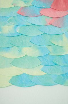 DIY tissue fish scales turned into art for a mermaid inspire room.