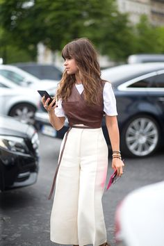 Miroslava Duma.  This is a weirdly very cute look: leather wrapped vest on t-shirt & culottes.   - HarpersBAZAAR.com
