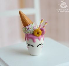 Miniature cocktail Unicorn in a glass with sweets. for dolls and doll houses. Scale 1:12. Handmade. Polymer clay. Dollhouse Miniature cocktail Unicorn in a glass with sweets is handmade from polymer clay. The cup and decor are not glued to the saucer. Not intended for small