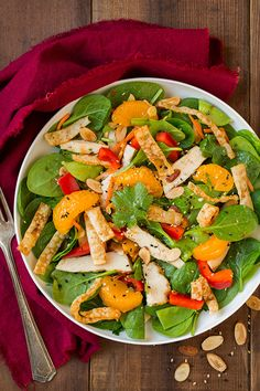 This Mandarine Orange Spinach Salad with Chicken and a Lemon Honey Ginger Dressing is out of this world delicious! You have to try this one! Salads used to