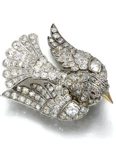 A VICTORIAN RUBY AND DIAMOND BROOCH LATE CENTURY. Designed as a roosting turtle dove the eyes highlighted with cabochon rubies the wings body and tail set with cushion-shaped circular-cut and rose diamonds detachable brooch fitting. Bird Jewelry, Animal Jewelry, Jewelry Art, Jewelry Design, Fashion Jewelry, Jewellery, Victorian Jewelry, Antique Jewelry, Vintage Jewelry