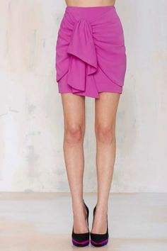 Pretty fuchsia skirt with layered tie detail.