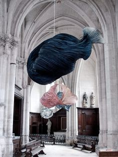 More than 100 of Peter Gentenaar's ethereal paper sculptures were hung inside the Abbey church of Saint-Riquier in France.