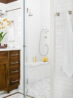 Like level in /zero threshold shoewer, tile work, cabinet color and bottom detailing - Bathroom Style