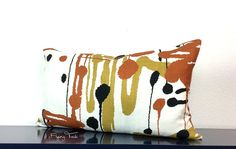 Handcrafted Gaston y Danielas Linen Pillow with 12 x 22 Down Insert. Same fabric on both sides. Knife Edge Finish. Colors are a Dark Orange or Cinnamon, Gold, Ivory, and Black. Perfect for Mid Century Modern Decor. From the Uptown Collection, this pattern is called Pensacola.  Pattern placement will vary from cover to cover.  Gaston y Daniela is a Designer, high end Linen fabric. They describe this pattern as follows: This design takes inspiration from the art of North America of the 1950s…