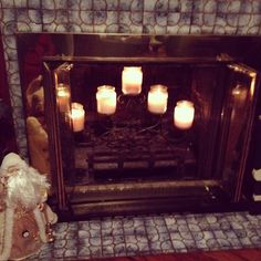 Candles in the fireplace I have such poor luck lighting a fire in my fireplace that I may give candles a try!