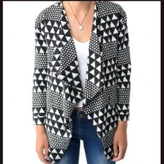 MinkPink Sparks Fly Waterfall Jacket The MinkPink Sparks Fly Waterfall Jacket features a small cuff in each arm and a waterfall style opening. It also features a black and white geometric pattern and lining inside. Self: 100% Viscose; Lining: 100% Polyester. MINKPINK Jackets & Coats Blazers