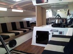 MacGregor 26 Interior with custom cushions and flooring. Looks very chic!