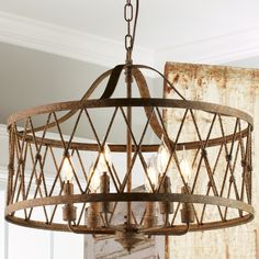"""Check out Faded Rustic Drum Cage Chandelier - 6 Light from Shades of Light Simple but never plain, this rustic drum-shaped chandelier showcases a rustic iron finish with hints of gold. Metal """"X rope"""" details form the attractive cage surround a 6-light candle cluster. Graceful bent arms, loop and chain hold the frame. Perfect in a foyer, living room, bedroom, office or dining room. May be hung as a semi-flush mount ceiling light."""