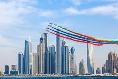 Al Fursan (The Knights in English), UAE Air Force Aerobatic team, flypast Dubai Marina smoking out UAE Flag colours, as part of 4th Dubai International Parachuting Championship (DIPC 2013). by Charlie Joe