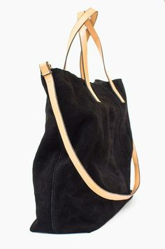 Inspired by the store's new neighborhood, this bag is sleek and stylish with a few unexpected elements - it's fully reversible from suede leather to canvas! www.mooreaseal.com
