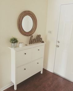 Our small entryway. Ikea Hemnes shoe cabinet.