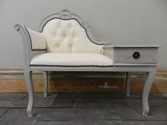 We have a beautiful telephone seat with ornate carvings that we have distressed to bring out even more of the character. The fabric has been transformed with Old White Chalk Paint™ and wax giving it an unusual almost leather like finish.