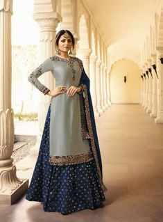 Grey and Blue satin georgette suit with brocade skirt. This suit is beatified with embroidery work. It comes with a matching chiffon dupatta and brocade bottom Indian Dresses, Indian Outfits, Navy Blue Lehenga, Indian Clothes Online, Lehenga Style, Salwar Kameez Online, Bridal Lehenga Choli, Anarkali Dress, Party Wear Dresses