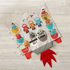 Shop Carry Home Rocket Ship. Blast off into space with our Carry Home Rocket Ship. Soft, foldable and filled with endless play, each panel of this on-the-go plush rocket ship features an abundance of appliqued and embroidered details.